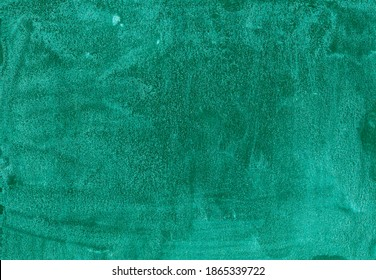 Emerald texture with glitter. Green iridescent background. Beautiful malachite texture. Green luminous color; background with sparkles. Abstract illustration; monochrome shades.