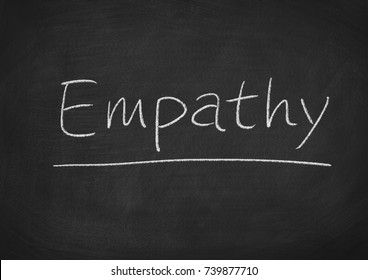 empathy concept word on a blackboard background