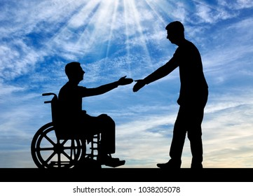 The employer intends to shake hands with a man in a wheelchair. The concept of providing work to people with disabilities