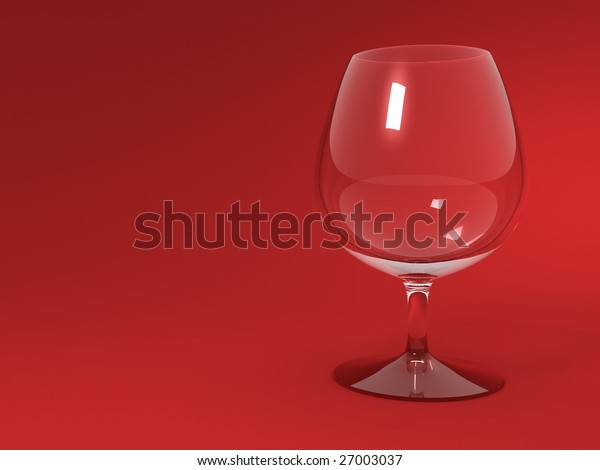 Empty cognac glass on red background.