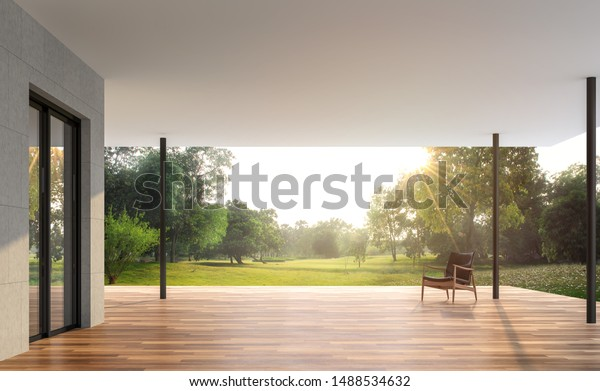 Empty contemporary terrace with garden view 3d render, There are wooden floor and concrete tile wall, funished with leather chair,looking out over the large garden in the morning.