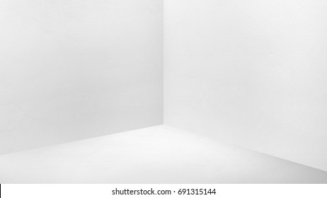 Empty corner white concrete wall and  floor perspective room,Modern style room,Mock up for display of product,business presentation