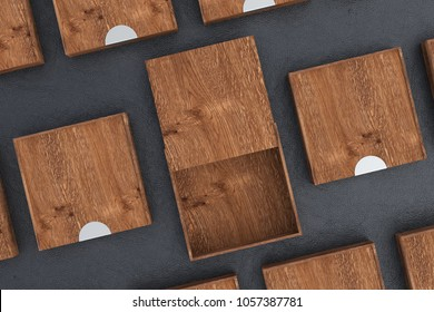 Empty dark wooden square box with opened sliding lid with closed boxes around on black background. 3d illustration
