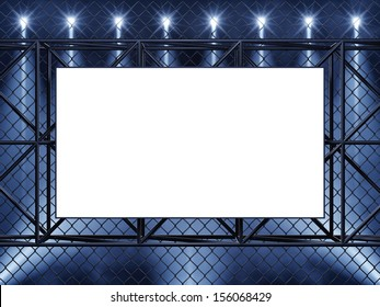 Empty display , chain-link fence and spotlights