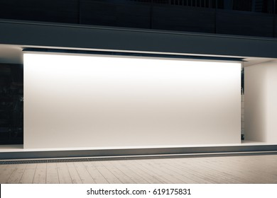 Empty glass shopfront with blank white banner at night. Retail  concept. Mock up, 3D Rendering