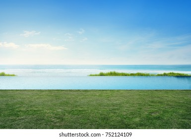 Empty grass floor deck in luxury beach house with blue sky background, Sea view terrace at vacation home or hotel, Photo and 3d rendering of swimming pool combined