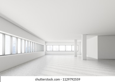 Empty industrial style office interior with white walls, a row of loft windows, columns and a mock up wall. Concrete floor and a cityscape. Front view 3d rendering