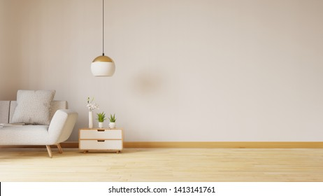 Empty living room with blue fabric sofa ,lamp and plants on empty white wall background.3d rendering