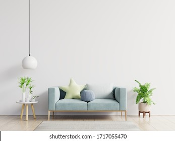 Empty living room with blue sofa, plants and table on empty white wall background. 3D rendering