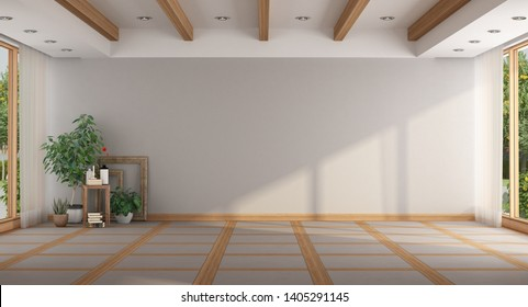 Empty minimalist large room with plants, window and wooden roof beams - 3d rendering