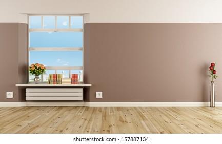 Empty modern interior with radiator under windowsill