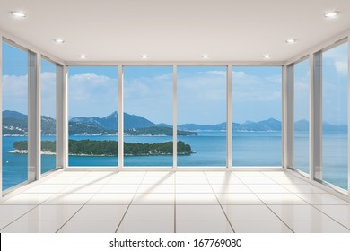 Empty modern lounge area with large bay window and view of sea
