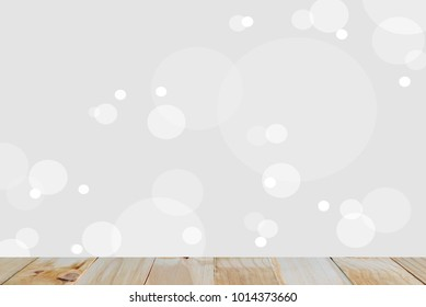 Empty natural wooden table top with blurred gray round abstract background  for backgroud