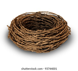 Empty nest as a symptom of children growing up and leaving the family house as a result the parents feel sad and lonely as a vacant single bird nest made of twigs on a white background.