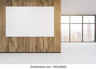 Empty office, wooden wall with white poster in front of panoramic window, New York view. Concept of new office. 3D rendering