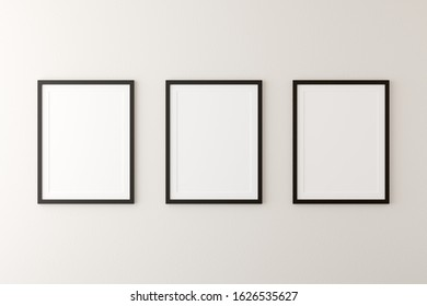 Empty picture frames hanging on white wall in bright room with copy space - portfolio, gallery or artwork template mock up - 3D illustration