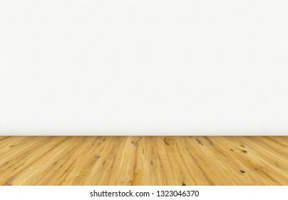 Empty room with brown wooden floor and blank white painted wall. Empty loft room for design interior.