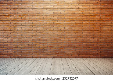 empty room with red brick wall and wooden floor