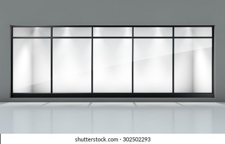 An empty shop front window display in a generic setting