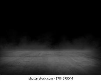 Empty spot lit concrete floor with fog, dark background