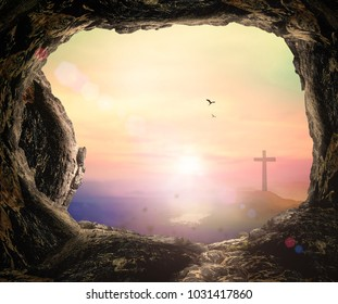 Empty tomb with cross on mountain sunrise background