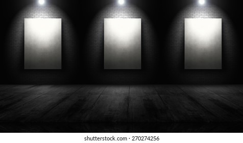 Empty white panels  in front of brick wall with spotlight