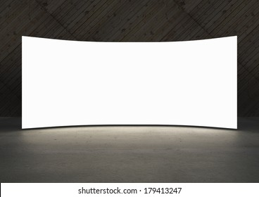 Empty white screen glows in dark abstract room