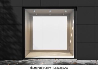 Empty white store showcase with illumination at daylight. Mockup. 3d rendering