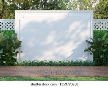 Empty white wall in the garden 3d render,  There is a wooden floor terrace,white wood lattice fence and nature background