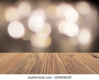 Empty wood surface with backdrop blurred bokeh lights background, product display