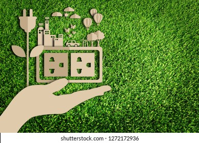 Energy saving concept. Paper art style of eco on green grass background. Save the earth. Green city.