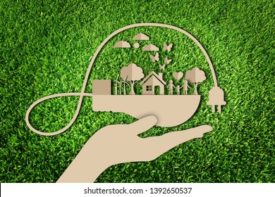 Energy saving concept. Paper art style of eco on green grass background. Save the earth.