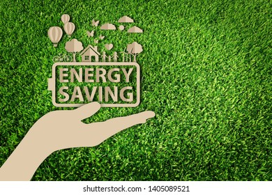 Energy saving concept. Paper art style of eco concept on green grass background. Save the earth.