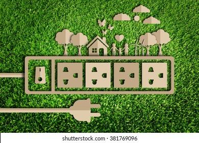 Energiesparkonzept.Papierschnitt des Ökos auf grünem Gras