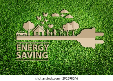 energy saving.  Paper cut of eco on green grass.