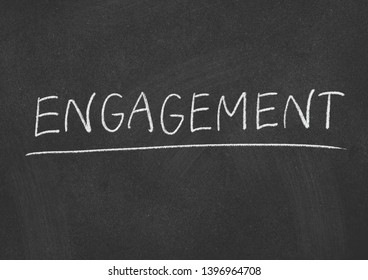 engagement concept word on a blackboard background