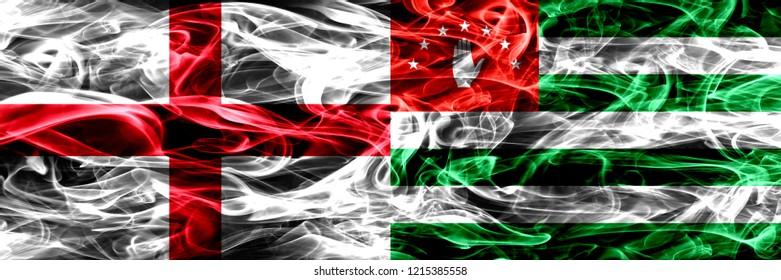England vs Abkhazia, Abkhazian smoke flags placed side by side. Thick colored silky smoke flags of English and Abkhazia, Abkhazian