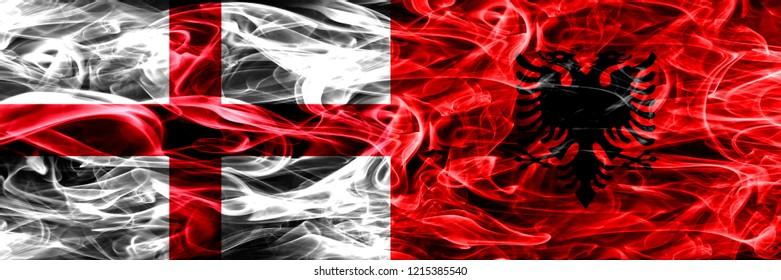 England vs Albania, Albanian smoke flags placed side by side. Thick colored silky smoke flags of English and Albania, Albanian