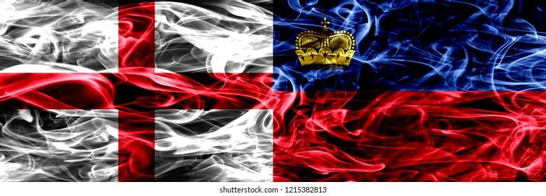 England vs Liechtenstein, Liechtensteins smoke flags placed side by side. Thick colored silky smoke flags of English and Liechtenstein, Liechtensteins