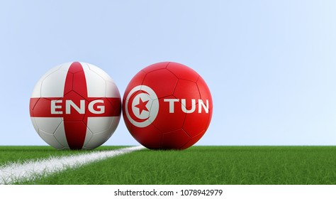 England vs. Tunisia Soccer Match - Soccer balls in Englands and Tunisias national colors on a soccer field. Copy space on the right side - 3D Rendering