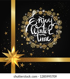 Enjoy winter time inscription written in frame made of golden and silver snowflakes raster on black with glittering elements, bow and ribbon decor