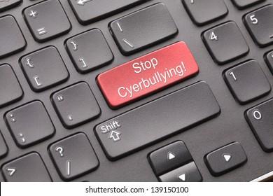 Enter key Stop cyberbullying on black keyboard