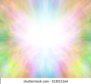 Ethereal healing angel light background - Butterfly shaped white energy formation on a rainbow pastel colored background