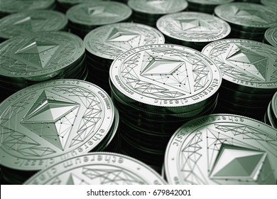 Ethereum classic (ETC) coins in blurry closeup. New cryptocurrency and modern banking concept. 3D rendering.