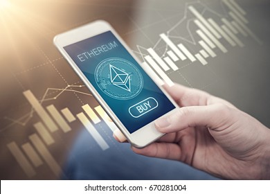 Ethereum crystal symbol on mobile app screen  with big BUY button. Ethereum growth  concept. New digital money.