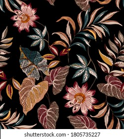 Ethnic leaves seamless pattern fabric textile design composed by ethnic vintage flowers and botanic plants antique on black background.