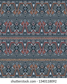 Ethnic seamless pattern with american indian traditional ornament in blue and gold colors. Tribal background. Aztec design for fabric. Print of native american art.