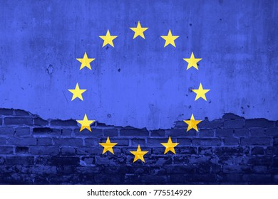 European Union flag on cracked wall texture background. Symbol, Politic Concept.