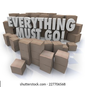 Everything Must Go words in 3d letters surrounded by cardboard boxes in a store warehouse to illustrate overstock inventory for a sale or clearnace event