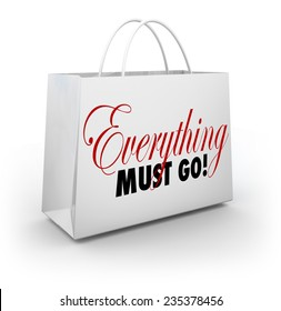 Everything Must Go words on a white shopping bag at a store holding a Going Out of Business sale to clear out its inventory